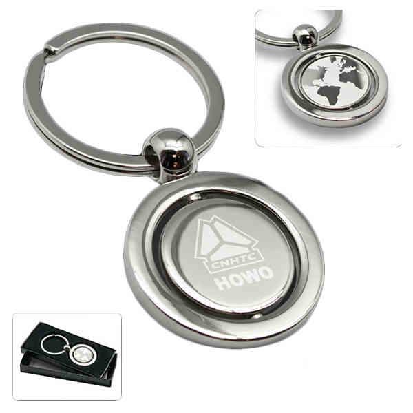 Revolving globe metal key
